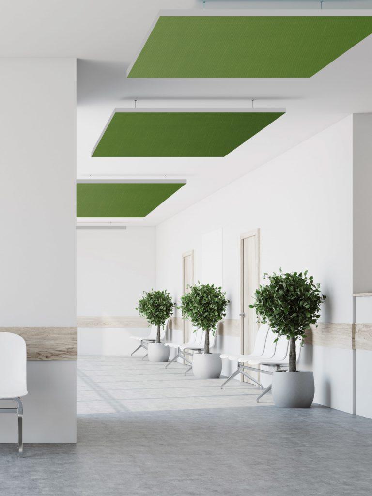 photo de cadres acoustiques de couleur verte suspendus