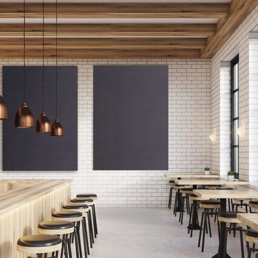 Photo de bafles acoustiques pour plafonds et murs imprimés bleu jeans en fixation mural dans un restaurant