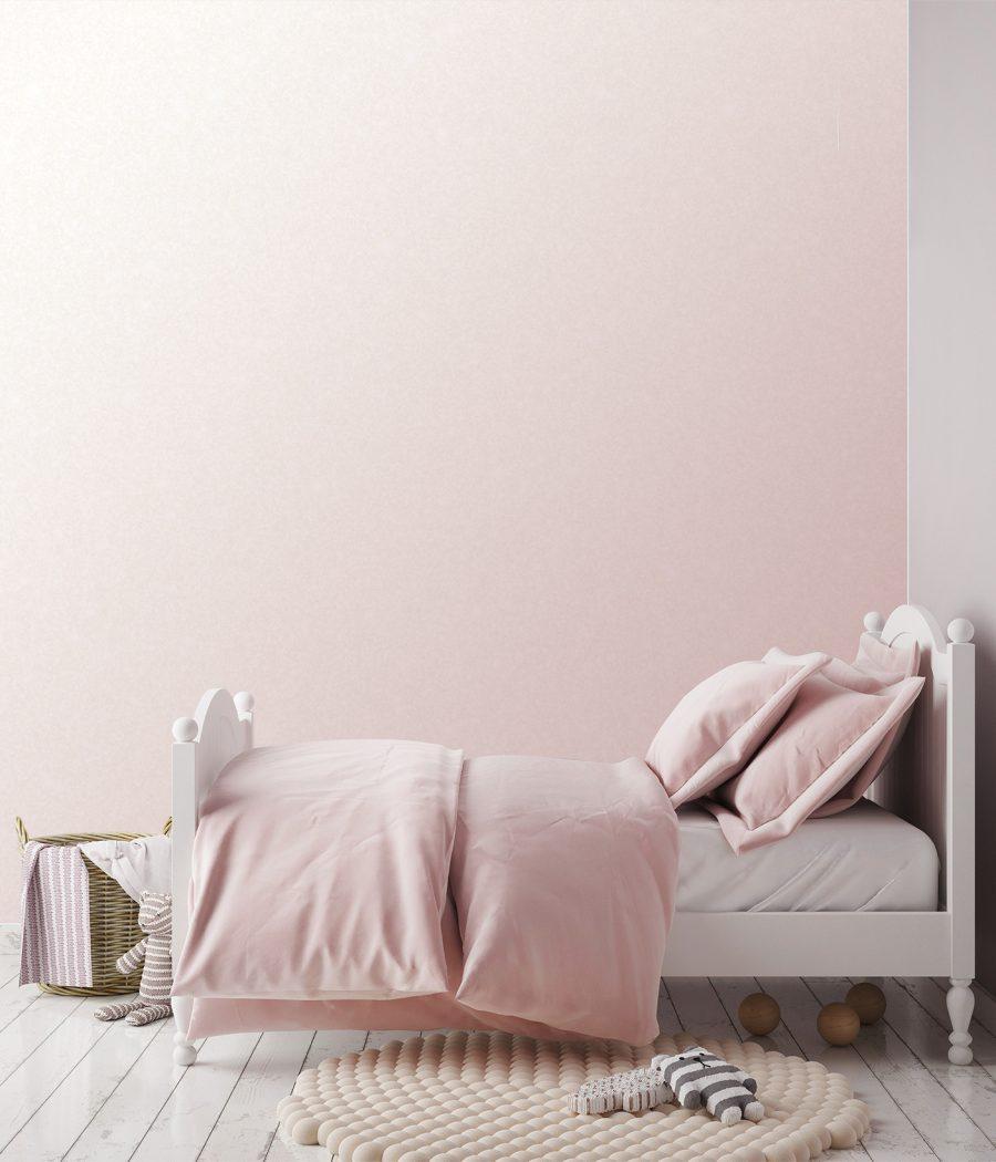 Photo d'un mur imprimé dans une chambre d'enfant sur un revêtement pailleté avec un dégradé de rose
